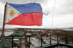Typhoon Aftermath: A Philippine flag flutters atop the control tower