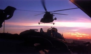 Helicopter over Greenpeace ship Arctic Sunrise