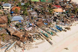 Typhoon Haiyan: An aerial view shows damaged houses in a coastal community