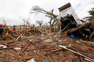 Typhoon Haiyan: A truck is seen slammed on a tree