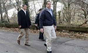 New York Governor Andrew Cuomo (R) arrives on the scene of a fatal passenger train derailment near the Spuyten Duyvil station