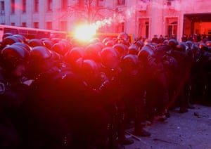 Ukraine protests: A flare thrown by protesters lands on riot police