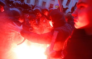 Ukraine protests: A flare is ignited as protesters clash with police