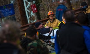 A man is taken away on a stretcher at the site of a Metro-North train derailment in the Bronx borough of New York December 1, 2013. At least four people were killed and 63 injur