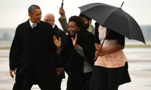 US President Barack Obama  is welcomed upon his arrival on Air Force One to attend a memorial service for Nelson Mandela at FNB Stadium in Johannesburg.