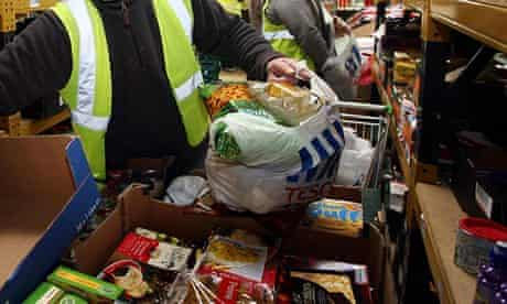 Workers at a food bank prepare food parcels