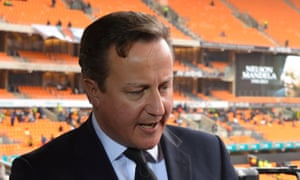 David Cameron gives an interview prior to the memorial service for the late Nelson Mandela at the FNB Stadium, Soweto, on 10 December 2013.