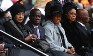 Nelson Mandela's widow Graca Machel, right, and his former wife Winnie Madikizela Mandela, left, sit on stage during the memorial service for Mandela.