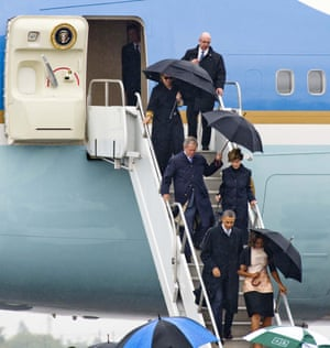 Who got the window seat? President Barack Obama with Michelle Obama, George W. Bush, Laura Bush and Hillary Clinton  arrive at Waterkloof Air Force Base Airport in South Africa.