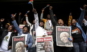 People sing and dance during the Mandela memorial event.