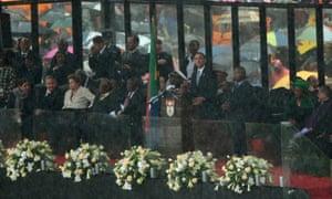 Cuban President Raul Castro, Brazilian President Dilma Rousseff, Andrew Mlangeni listen as United States President Barack Obama speaks during the official memorial service for former South African President Nelson Mandela at the FNB Stadium.