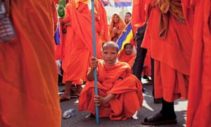 A young Buddhist monk rests after his arrival, following an extended march, outside the Cambodian National Assembly in Phnom Penh, Cambodia. Various groups of activists, political parties, monks and humanitarian organisations are holding events for International Human Rights Day in the Cambodian capital.