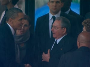 US president Barack Obama shakes hands with Cuban President Raul Castro in this still image taken from video courtesy of the South Africa Broadcasting Corporation