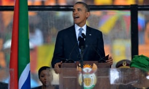 Barack Obama delivers a speech during the memorial service for Nelson Mandela.