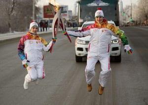 The Winter Olympic torch relay is carried through the Siberian city of Omsk, Russia, ahead of the Sochi 2014 Winter Olympics.