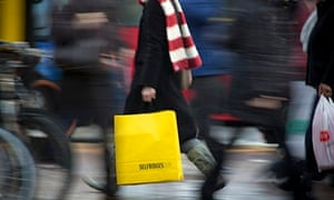 A man carrying shopping bags on Oxford Street