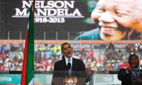 President Barack Obama speaks to crowds attending the memorial service for former South African president Nelson Mandela.