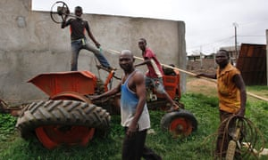 Christians remove parts from a tractor at a mosque compound in Bangui. The French army said it has restored some stability in the capital of Central African Republic after battling gunmen on Monday in an operation to disarm rival Muslim and Christian fighters responsible for killing hundreds since last week.