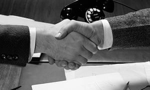 Two business men shake hands