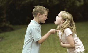 A boy and a girl fighting