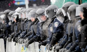 Interior Force soldiers stand near the City Hall in Kiev, Ukraine as thousands of protesters continued to demand the government's resignation.