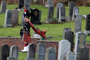 A piper arrives for the funeral of Police Constable Tony Collins, at Lamlash Cemetery on the Isle of Arran. The father-of-three was on board the police helicopter when it crashed into the Clutha bar in Glasgow's Stockwell Street.
