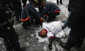 Firemen and police cut loose a protester blocking the entrance of an immigrant detention centre in Elizabeth, New Jersey, US. The protest was designed to draw attention to the continued mass deportations of undocumented immigrants by the US Immigration.