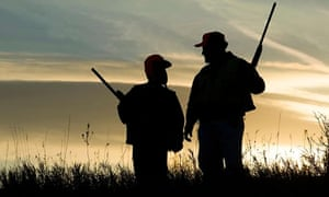 Father and child finish a day of bird hunting.