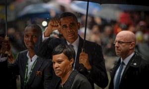 Barack Obama gestures at Nelson Mandela's public Memorial Service at the FNB stadium in Johannesburg, South Africa.