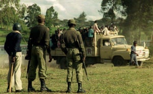 Kenya at 50: Members of the Kenyan Army watch opposition supporters