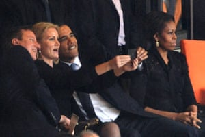 The Presidential selfies: US President  Barack Obama (R) and British Prime Minister David Cameron pose for a picture with Denmark's Prime Minister Helle Thorning Schmidt (C) next to US First Lady Michelle Obama (R) during the memorial service of South African former president Nelson Mandela at the FNB Stadium in Johannesburg.