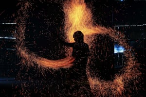 """A fire dancer performs during the """"Art of Fire"""" show in Pasay City, Philippines. The """"Art of Fire"""" showcases choreographed circus artistry through fire dancing."""