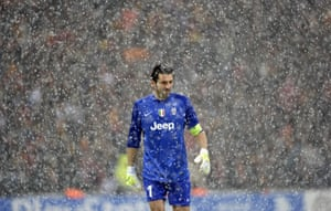 Juventus' goalkeeper Gianluigi Buffon leaves the pitch after a heavy snow fall halted the UEFA Champions League group B football match between Juventus and Galatasaray at the TT Arena Stadium in Istanbul, Turkey.