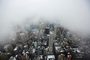 Low lying clouds from a snowstorm obscure the skyline of New York.
