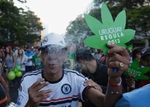 """Historical high: People participate in the so-called """"Last demonstration with illegal marijuana"""" on their way to the Congress building in Montevideo, as  Senate debates a government-sponsored bill establishing state regulation of the cultivation, distribution and consumption of marijuana. The senate is expected to pass the law making the small South American nation the world's first to allow its citizens to grow, buy and smoke marijuana."""