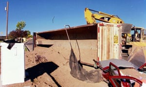 The scene in Albuquerque after a semi-trailer carrying sand overturned, suffocating a woman