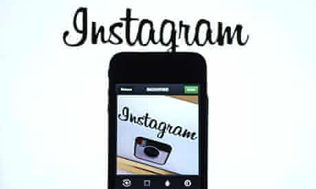 The Instagram logo is displayed on an smartphone