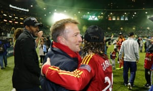 Jason Kreis hugs Ned Grabavoy after Real Salt Lake reached the 2013 MLS Cup final
