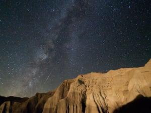 Perseid meteor over cliffs