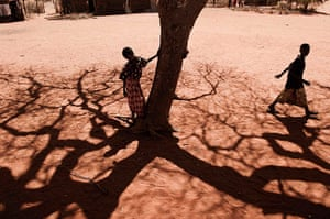 Kenya at 50: A boy stands next to a tree in Barmil