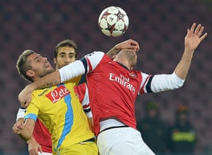 Napoli v Arsenal: Gokhan Inler gets stuck in with Olivier Giroud