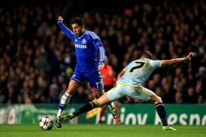 chelsea v steau: Eden Hazard evades the tackle from Alexandru Chipciu