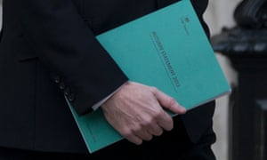 George Osborne leaving the Treasury holding a copy of the autumn statement 2013.