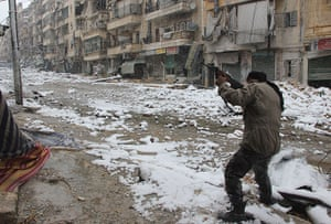 Winter in Syria: A rebel fighter aims his weapon as he stands amidst snow during clashes wit
