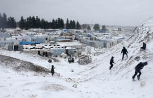 Winter in Syria: Syrian refugees play with snow in Lebanon's Bekaa Valley a few kilometres f