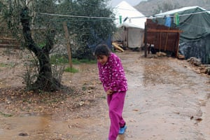 Winter in Syria: A Syrian refugee girl walks near her tent in a camp in Ketermaya, Lebanon.
