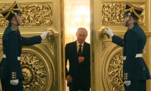 President Vladimir Putin enters the St. George's Hall of the Grand Kremlin Palace for his annual address to the Federal Assembly in Moscow, Russia.