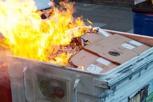 Cops off campus protest: Burning bin at Cops off campus protest