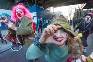 Cops off campus protest: Clown protestors cops off campus