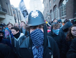 Cops off campus protest: protestor in a police hat cops of campus
